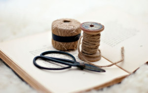 scissors and twine on a book